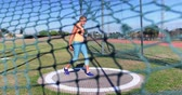 olympic : Female athlete getting ready for discus throw at sports venue 4k Stock Footage