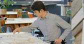 architectural model : Male executive working on architectural model in the office 4k