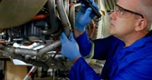 aeroespaço : Male engineer examining an aircraft engine in hangar 4k Stock Footage