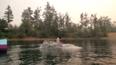 rampa : Man wakeboarding in the river on a sunny day 4k