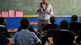 tanítás : Male teacher teaching students in the classroom at school 4k