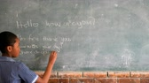estudioso : Schoolgirl writing on chalkboard in classroom at school 4k
