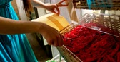 úsek : Close-up of woman packing snacks in supermarket. Woman shopping in supermarket 4k