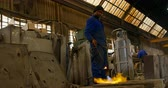 mamada : Male worker heating molds in workshop. Male worker holding blow torch 4k