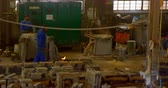 mamada : Male worker heating mold in workshop. Mlae worker holding blow torch 4k