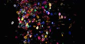 multimídia : Close-up of confetti falling from the top. Multicolored confetti against black background, celebration concept 4k Stock Footage