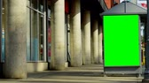 chave : Led hoarding on the exterior of telephone booth. Green screen display on the telephone booth