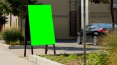 технология : Empty menu board on the street. Green screen display on the menu board