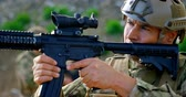 campo de batalha : Front view of mid-adult caucasian military soldier rifle training in fields during training. He is aiming rifle on field 4k