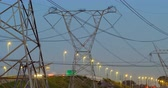 electricity pole : Time lapsed of electricity pylon near highway at dusk. Land vehicles moving on the background 4k