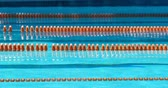 po celé délce : Lanes of a competition swimming pool. Empty swimming pool with lane marker 4k