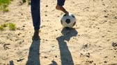 footballeur : Player playing football in the ground. Boy kicking the ball in the sports ground