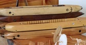 инструментальный : Close-up of wooden loom shuttle in a empty workshop. Weaving Tool equipment 4k