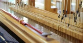 mekik : Close-up of hand loom machine in a empty workshop. Threads on a hand loom machine 4k Stok Video