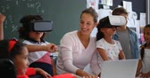 schoolchildren : Front view of Mixed-race schoolkids using virtual reality headset with teacher and classmates in the classroom. 4k
