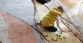 calvo : High angle view of African american boy playing with building blocks in a comfortable home. He is sitting on floor. 4k