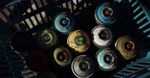paint spray : Close-up of aerosol cans arranged in the basket on a sunny day. Multi colored aerosol cans 4k Stock Footage