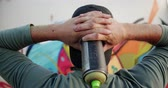grafiti : Rear view of Caucasian graffiti artist with hands behind head looking at graffiti wall. He is holding aerosol can 4k