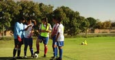 tênis : Front view of diverse female soccer team discussing tactics on soccer field on sunny day. 4k