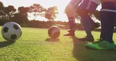 슬리밍 : Low angle view of diverse female soccer team training to pass ball on soccer field 4k