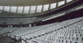 alto : High angle view of empty spectators seat in a stadium. Spectators seats arranged in a row 4k
