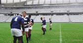 trikot : Front view of diverse rugby players playing rugby match in stadium. Empty spectators seat in the background 4k