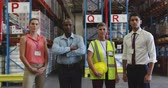 havran : Portrait close up of a diverse group of warehouse workers standing together in a warehouse loading bay, looking straight to camera. They are working in a freight transportation and distribution warehouse. Industrial and industrial workers concept 4k Dostupné videozáznamy