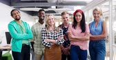 generation z : Portrait close up of a team of diverse creative professionals smiling to camera with arms crossed in a modern open plan office