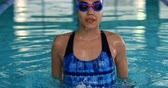 generation z : Front view of a young mixed race female swimmer in a swimming pool