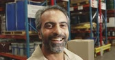 półka : Portrait close up of a middle aged mixed race male warehouse worker standing smiling to camera in a warehouse loading bay