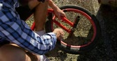 sabitleme : Overhead low section view of a young Caucasian man repairing the wheel of his BMX bike