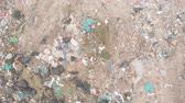 escavadeira : Drone shot of vehicles working, clearing and delivering rubbish piled on a landfill full of trash. Global environmental issue of waste disposal.
