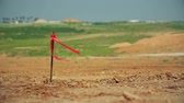 ribbon : Metal survey peg with red flag on construction site Stock Footage