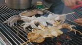 squid tentacles : Street food-grilled squid in Kaohsiung Taiwan Stock Footage
