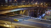 nowoczesny budynek : Hyperlapse aerial view of highway bridge with busy traffic in nigth Taipei city