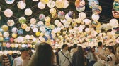 gece vakti : KAOHSIUNG, TAIWAN - March 04: People visit Lantern Festival in Kaohsiung March 04, 2018 in Kaohsiung, Taiwan. Stok Video