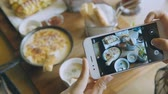 dish photo : Closeup hand holding phone shooting food photograph Stock Footage
