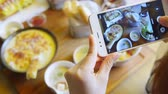 shoot vegetable : Closeup hand holding phone shooting food photograph Stock Footage
