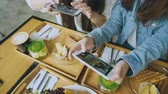 food photo : Happy Friends With Smart Phones Taking Picture In Restaurant