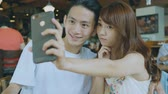 milenec : Young Couple Taking Selfie In Coffee Shop