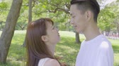 amante : Young Asian Couple In The Park Stock Footage