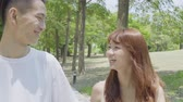namoro : Young Asian Couple In The Park Stock Footage