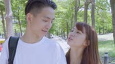 diyalog : Young Asian Couple In The Park Stok Video