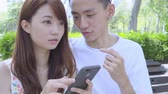 японский : Young Asian Couple In The Park Стоковые видеозаписи