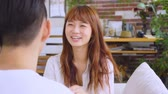 diyalog : Asian Couple Chatting In The Living Room Stok Video