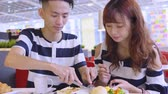 milenec : Young Couple Enjoying Breakfast At Coffee Shop