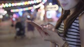 göndermek : Woman Use Of Smart Phone In City At Night Stok Video