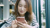tapping : Business Woman Using Smart Phone At Coffee Shop
