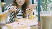 브런치 : Asian Woman Eating Breakfast