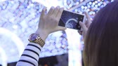 tünel : Young girl photographing Christmas celebration light tunnel Stok Video